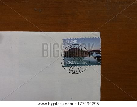 REYKJAVIK ISLAND - CIRCA MARCH 2017: mail stamp from Island showing wild nature with river and falls