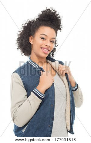 Teenage model with urban fashion clothes isolated on a white background