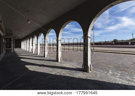 Barstow, California, USA - March 11, 2017:  View behind the arches at the historic Barstow Harvey House Train Station in the Mojave Desert.