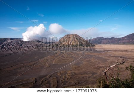 Mount Bromo an active volcano with clear blue sky at the Tengger Semeru National Park in East Java Indonesia.