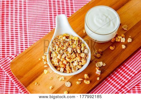 focus the dried cereal and Pair with yogurt. The symbol of healthy nutrition put on the wood background Healthy eating concept