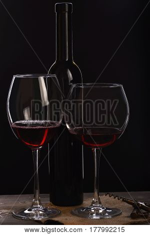 Wineglasses With Bottle, Corkscrew On Wooden Table With Sackcloth Napkin