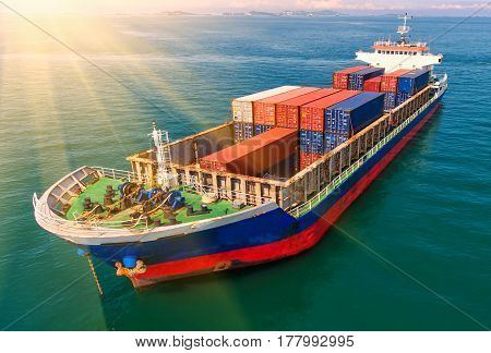container ship in import export and business logistic.By crane Trade Port Shippingcargo to harbor.Aerial view.Water transport.International.Shell Marine.Top view.
