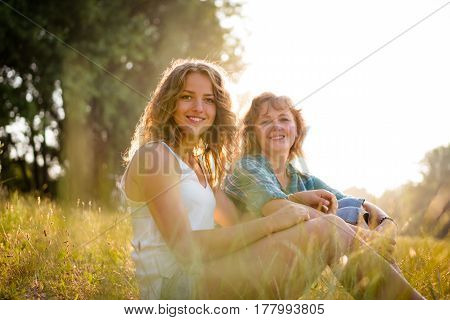 Mother and teenage daughter expressing positive emotions