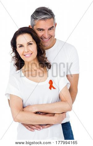 Couple supporting aids awareness together over white background