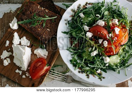 plate of green salad with vegetables on background