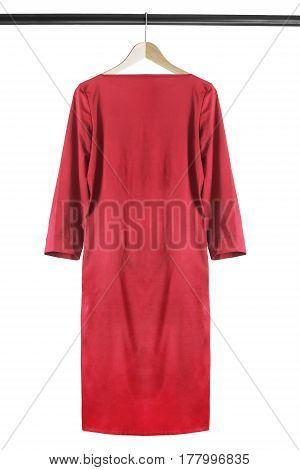 Elegant red silk dress on wooden clothes rack isolated over white