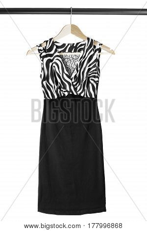 Combined elegant silk dress on wooden clothes rack isolated over white