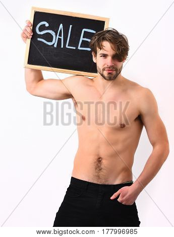 Bearded man short beard. Caucasian sexy young macho with stylish hair moustache shows muscular torso holding black board with sale inscription isolated on white studio background