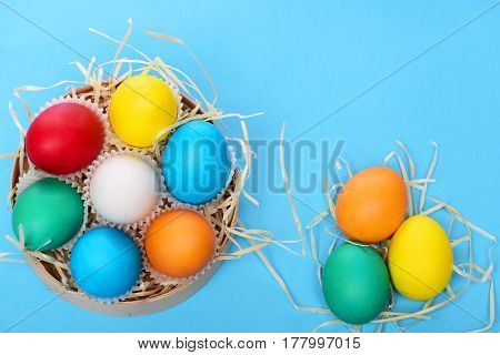 Painted Easter Colorful Eggs In Wooden Box On Blue Background