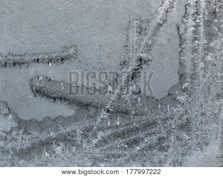 The cold night has made the glass frosty.