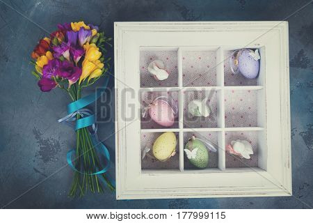 Easter tic tac toe game with eggs and rabbits in box - pastel colors and rustic style, retro toned