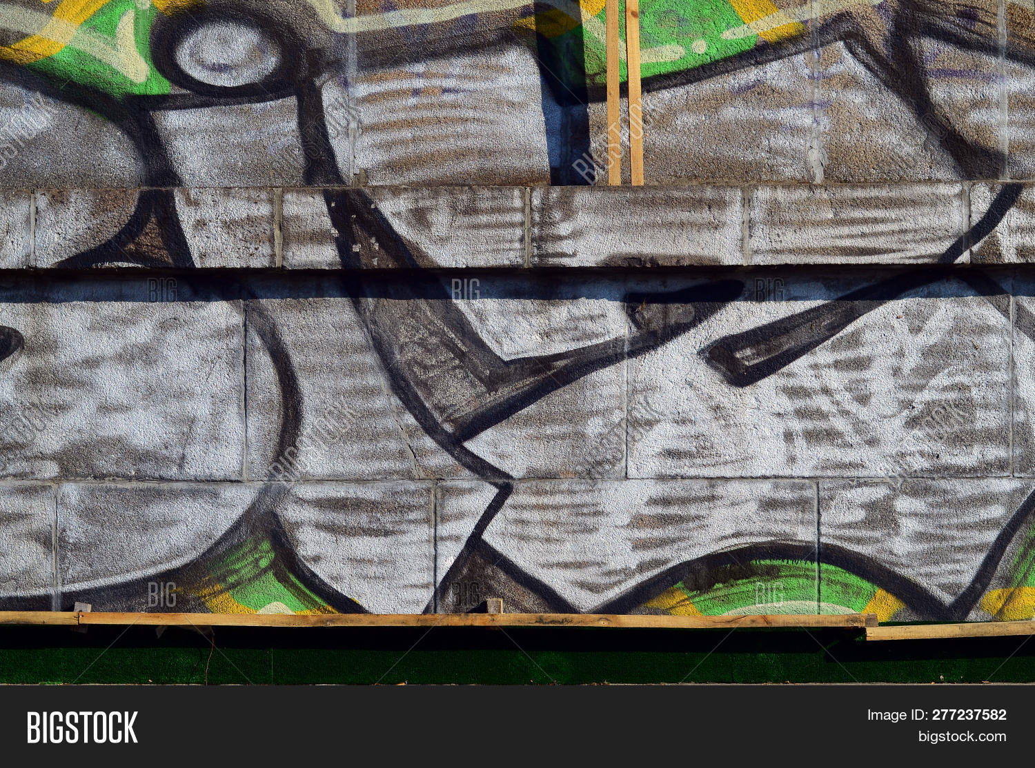 Grungy concrete surface with graffiti colors and outlines street art background texture close up painted wall of the city