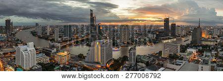 Beautiful Sunset Curve Chao Phraya River Panoramic Cityscape Of Bangkok City At Night On 2018 , Pano