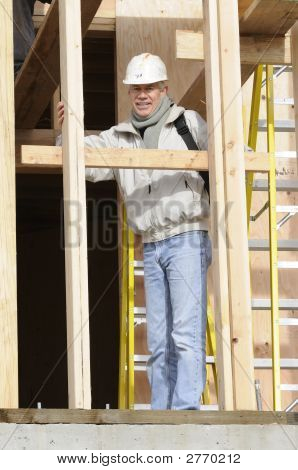 Carpenter Checking Teeth On Saw