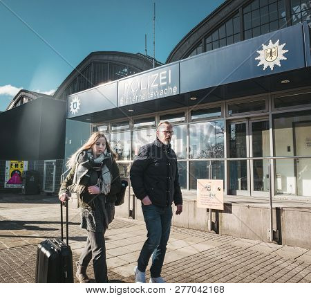 Hamburg, Germany - Mar 20, 2018:man And Woman Passing By Police Polizei Station Near Hamburg Central