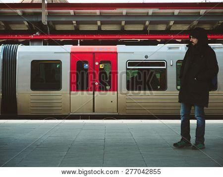 Hamburg, Germany - Mar 20, 2018: Man Waiting For The Train At Platform Of Hamburg Train Station With