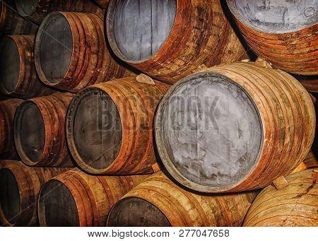 Old Oak Barrels In The Wine Cellar