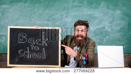 Welcome Back. Teacher Or School Principal Welcomes With Blackboard Inscription Back To School. Begin