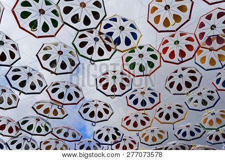 Colorful Umbrellas Hanging Over The Street In Camara De Lobos On Portuguese Island Of Madeira