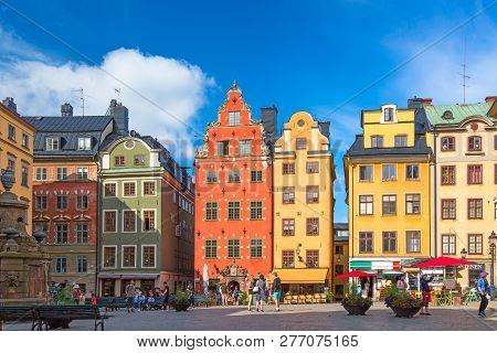 Stockholm, Sweden - July, 2018: Colorful Facade Of The Houses In Stortorget Square Gamla Stan. Stock