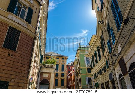 Piazza della Meridiana square with multicolored typical traditional buildings with colorful walls, windows with shutters in historical centre of old european city Genoa (Genova), Liguria, Italy poster