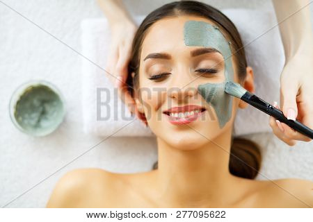 Beautiful Young Woman Getting A Face Treatment At Beauty Salon.skin And Care. Beautiful Woman Lying