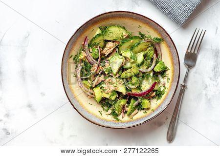 A Bowl With Tuna Fish And Avocado Salad