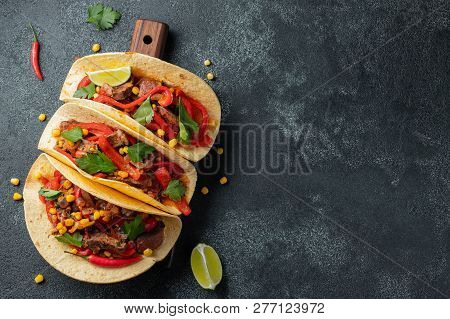 Mexican Tacos With Beef, Vegetables And Salsa. Tacos Al Pastor On Wooden Board On Black Background.