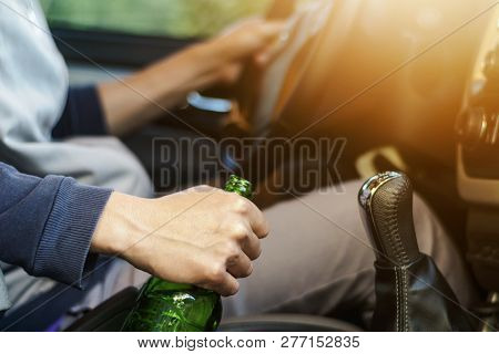 Drinking And Driving , Man Drinking Alcohol And Using Mobile Phone While Driving Car , Concept Drive