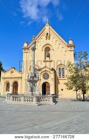 Bratislava, Slovakia. Capuchin Church Of St. Stephen In A Sunny Summer Day