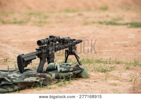 assault rifle 5.56X45 caliber with scope and bipod poster