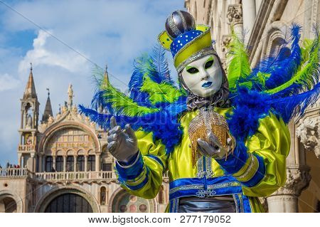 Venice, Italy - February 9: Carnival In Venice. A Beautiful Venetian Mask Shows The Famous City In F