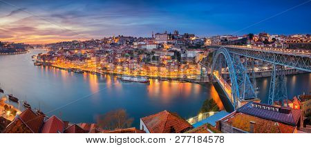 Porto, Portugal. Panoramic Cityscape Image Of Porto, Portugal With The Famous Luis I Bridge And The