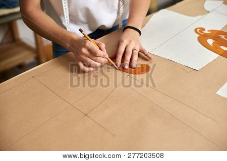 Workplace In Design Studio. Female Designer Hands Close-up Making Drawing Of Woman Skirt Detail Patt