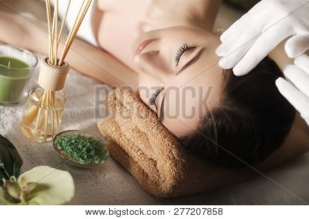 Spa. Face Massage. Spa Skin And Body Care. Close-up Of Young Woman Getting Spa Massage Treatment At