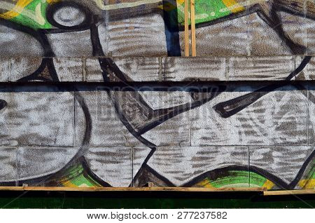 Concrete Weathered Worn Wall Damaged Paint. Grungy Concrete Surface With Graffiti Colors And Outline