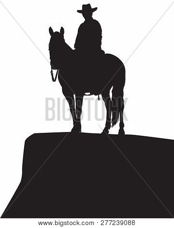 A Cowboy Sits Astride His Horse On A Rocky Bluff In Silhouette