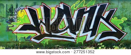 The Old Wall, Painted In Color Graffiti Drawing Green Aerosol Paints. Background Image On The Theme