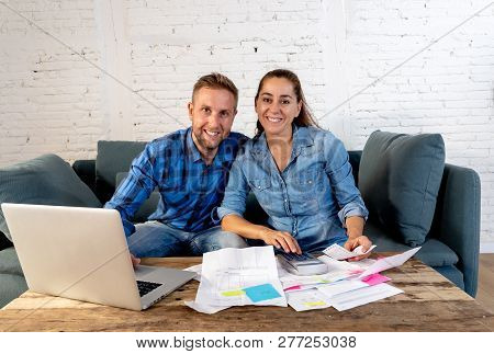 Young Happy Young Couple Paying Bills With Laptop Feeling Fortunate And Lucky Off Debts