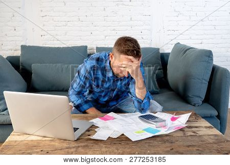 Angry Man Paying Bills Managing Finances Feeling Desperate And Hopeless With Too Much Debts