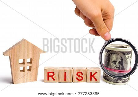 Wooden House And The Inscription Risk. The Concept Of Financial Risk To Buy Or Sell Property. Invest