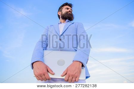 Man Bearded Hipster Manager Hold Laptop Blue Sky Background. Top Qualities Of Excellent Manager. Man