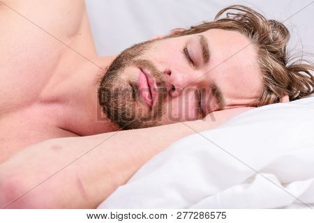 Get adequate and consistent amount of sleep every night. How much sleep you actually need. Bearded man sleeping face relaxing on pillow. Expert tips on sleeping better. Man handsome guy lay in bed poster