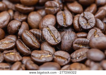 Coffee Beans Texture Background. Brown Roasted Coffee Beans. Closeup Shot Of Coffee Beans. Coffee Be