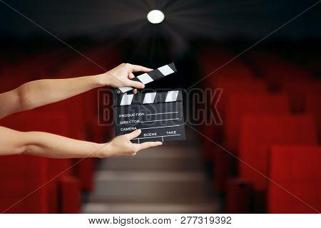 Hands Holding Director Movie Clapper In Cinema Theatre