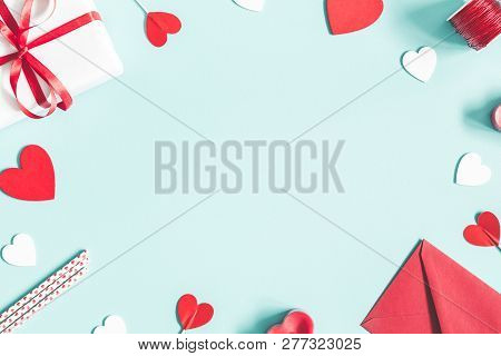 Valentine's Day Background. Gifts, Candle, Confetti, Envelope On Pastel Blue Background. Valentines