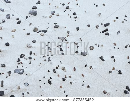 Beach Sand With Pebbles And Shells. Sea Pebble Stones Between Sand. Small Stones On Beach And Smooth