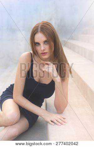 Beautiful red head model, classic model features, gorgeous blues eyes.