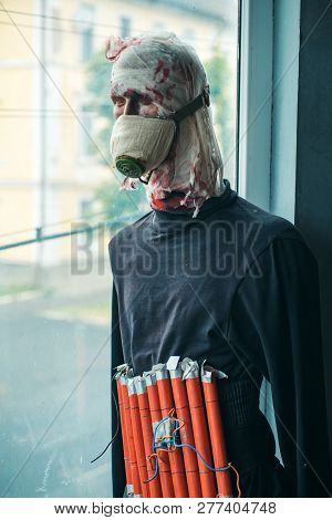 A serious crime. Terrorist wear fake suicide bombers belt. Suicide attacker. War soldier or victim. Terrorist bomber in gas mask dummy casualty in head. War or terrorism attack. Countering terrorism. poster